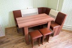 Kitchen angular sofa and table Royalty Free Stock Photo