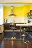 Kitchen in apartment. Kitchen with yellow walls and breakfast bar Stock Photography