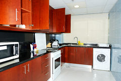 Kitchen in the apartment of luxury hotel Stock Photography