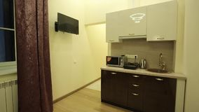Kitchen in apartment. Pan shot stock footage