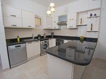 Kitchen area in luxury apartment Royalty Free Stock Photos