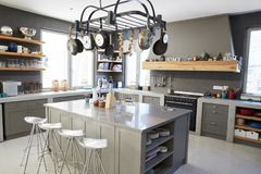 Kitchen Area Of Modern Home Interior With Island And Appliances royalty free stock images