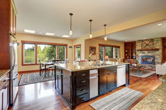 Kitchen area with open floor plan, view of living room and dining room. Small kitchen area with open floor plan, view of living room. Kitchen room has black royalty free stock photography