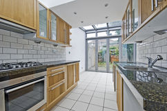 Kitchen with atrium. Modern luxury kitchen unit with bright atrium stock images