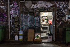 Kitchen backdoor. Melbourne, Australia - April 22, 2015: View through a kitchen backdoor in the alleyways of Melbourne stock photos