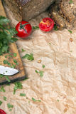 Kitchen background with baking paper, tomatoes, radish and parsley. Copy space Royalty Free Stock Photography