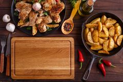 Kitchen background, cooking concept. Empty chopping board, grill royalty free stock images
