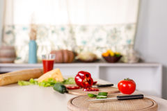 Kitchen background with vegetables, knife and boards Stock Image