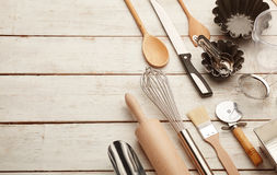 Kitchen baking utensils. Against white desk Royalty Free Stock Image