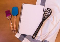 Kitchen baking utensils and empty notebook Stock Image