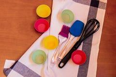 Kitchen baking utensils on wooden background Royalty Free Stock Photos