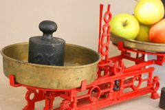 Kitchen balance scale. Old vintage kitchen balance scale with apples and weights Stock Photo