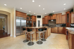 Kitchen with bar stools Royalty Free Stock Photography