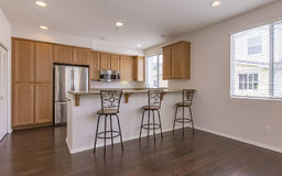 Kitchen with bar and stools in luxury San Diego townhouse. Model home kitchen in southern California ready for a real estate shoot Stock Photography