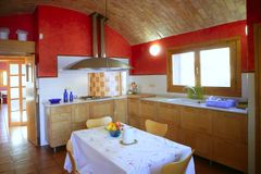 Kitchen with barrel vault ceeling. Kitchen with barrelt vault ceeling, red wall in mediterranean style Stock Images