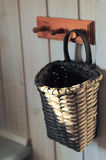 Kitchen basket on wooden hanger Royalty Free Stock Photography