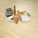 Kitchen belongings on bright parquet Royalty Free Stock Images
