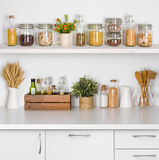 Kitchen bench shelves with various food ingredients on white background Royalty Free Stock Photography