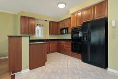 Kitchen with black appliances Royalty Free Stock Photo