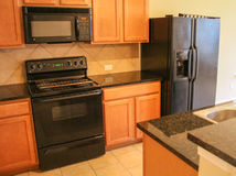 Kitchen with Black Appliances. Kitchen with black alliances and wood cabinets Royalty Free Stock Photos