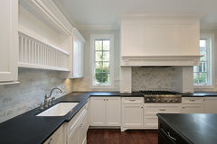 Kitchen with black countertops Royalty Free Stock Photos