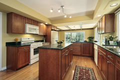 Kitchen with black granite counters Stock Image