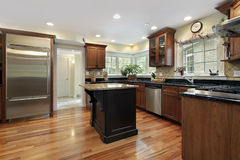 Kitchen with black and granite island Stock Photo