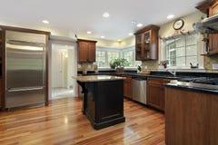 Kitchen with black and granite island. Kitchen in luxury home with black and granite island stock photo