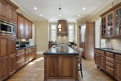 Kitchen with black granite island top Stock Photo