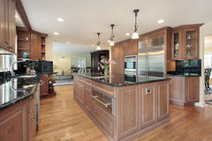Kitchen with black marble countertops. Kitchen in luxury home with black marble countertops Royalty Free Stock Image