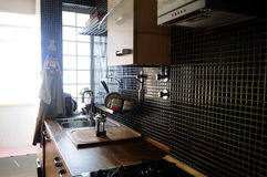 Kitchen with Black Tiles and Natural Wood Counter Royalty Free Stock Photo