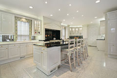 Kitchen with black top marble island Stock Photography