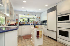Kitchen with blue countertops Royalty Free Stock Image