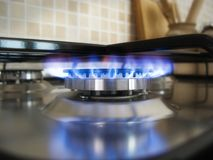 Kitchen blue flame on a burner Stock Image