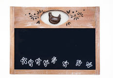 Kitchen Board. A slightly cropped closeup on a nicely decorated kitchen black chalk board with floral decoration and a chicken Royalty Free Stock Images