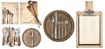 Kitchen board, aged recipe paper, blackboard and vintage cutlery stock photo