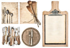 Kitchen board, aged recipe paper and vintage cutlery. Isolated on white background. set of kitchen utensils Royalty Free Stock Photos