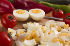 Kitchen board with finely chopped eggs Royalty Free Stock Image