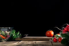 Kitchen board with free place with fresh vegetables Stock Photos