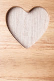 Kitchen board with heart shape as border frame Royalty Free Stock Photography
