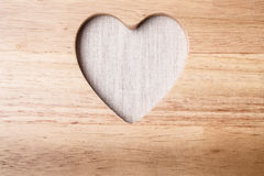 Kitchen board with heart shape as border frame Stock Photo