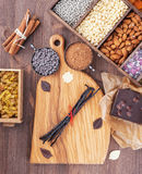 All for baking chocolate. Kitchen board with prepared ingredients for baking Royalty Free Stock Photo
