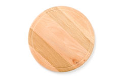 Kitchen board. Wooden round kitchen board on a white background Stock Image