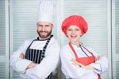 Kitchen boss. secret ingredient by recipe. cook uniform. man and woman chef in restaurant. Family cooking. Menu planning stock photos