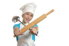 Kitchen boy holding battledore and ladle Royalty Free Stock Images