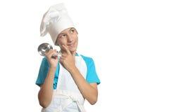 Kitchen boy thinks Royalty Free Stock Photo