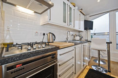 Kitchen with breakfast bar Royalty Free Stock Photos