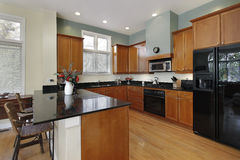 Kitchen with breakfast bar Royalty Free Stock Images