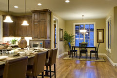 Kitchen & Breakfast Nook. Kitchen from Hallway Perspective. Shows cooking island, floor, and nook Stock Image