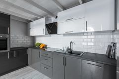 Kitchen with brick tiles. Modern kitchen with white brick tiles and wooden ceiling royalty free stock photography
